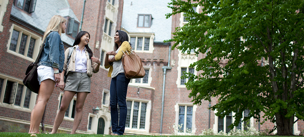 students chatting in Stone-Davis courtyard